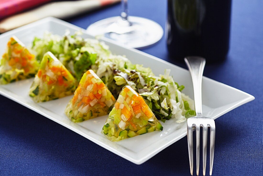 Vegetable aspic with salad and pumpkin seed oil