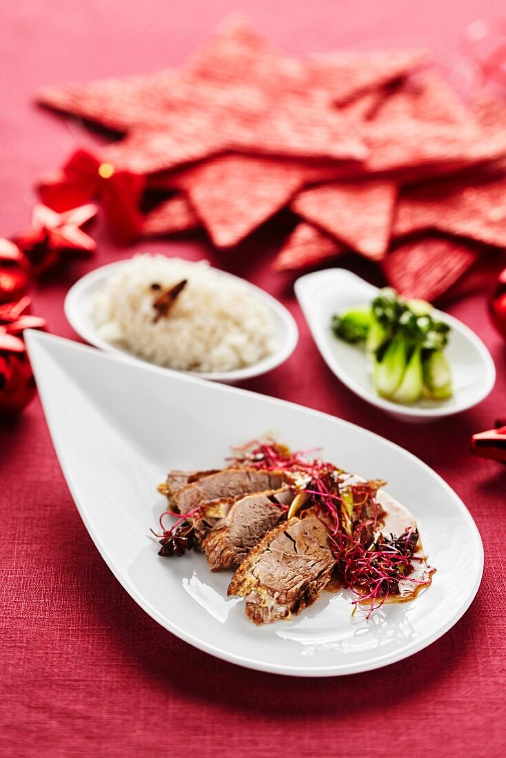 Oriental Christmas goose with rice and bok choy