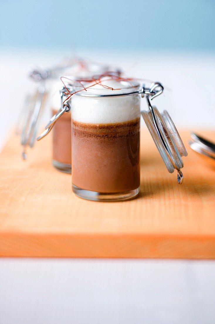 Grand Cru chocolate pudding with sour cream and chilli foam in jars