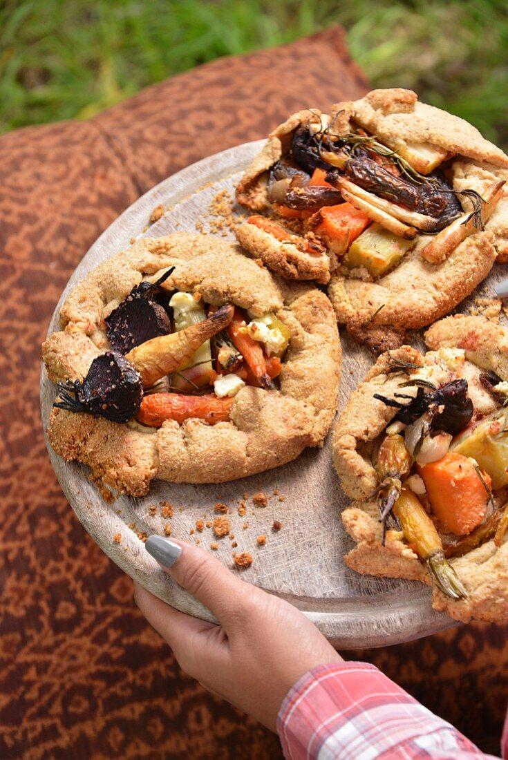 Galettes made of Paremsan dough with roasted vegetables for a winter picnic (South Africa)