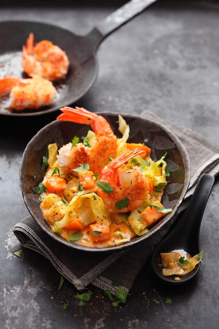 Prawns on a winter vegetable and coconut ragout
