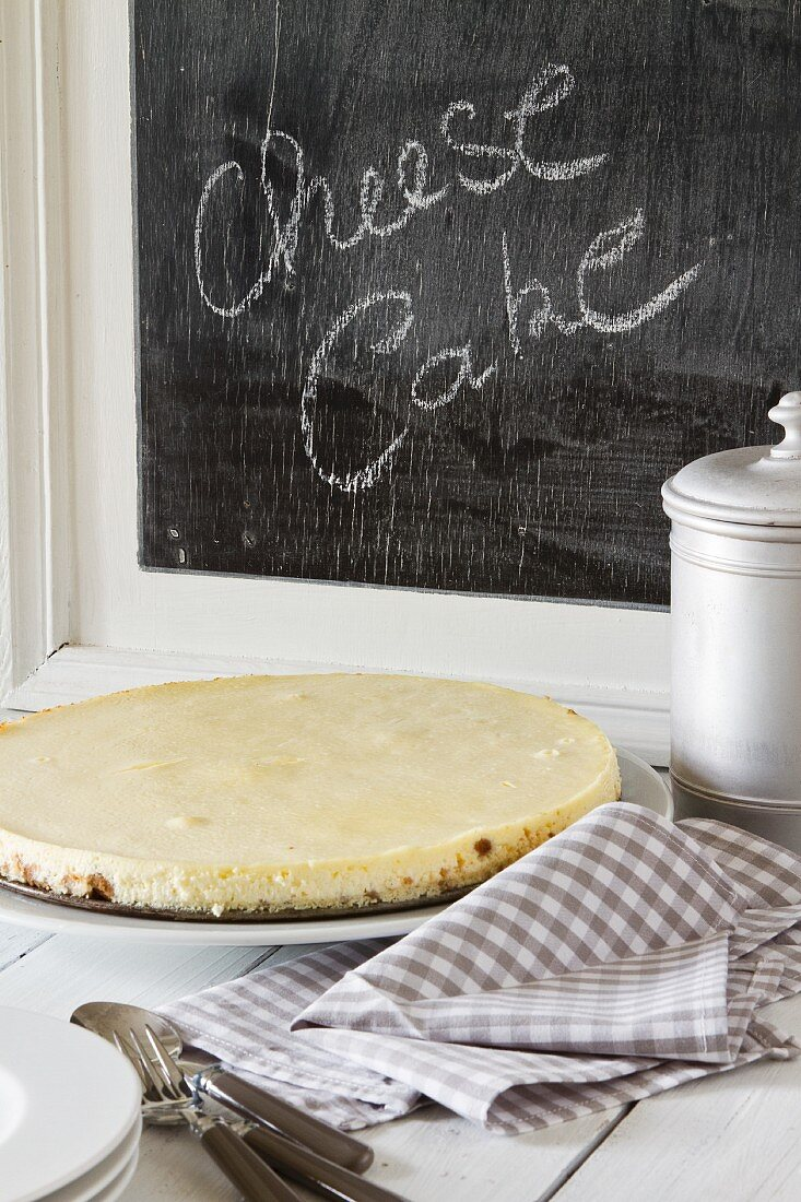 Cheesecake in front of a blackboard