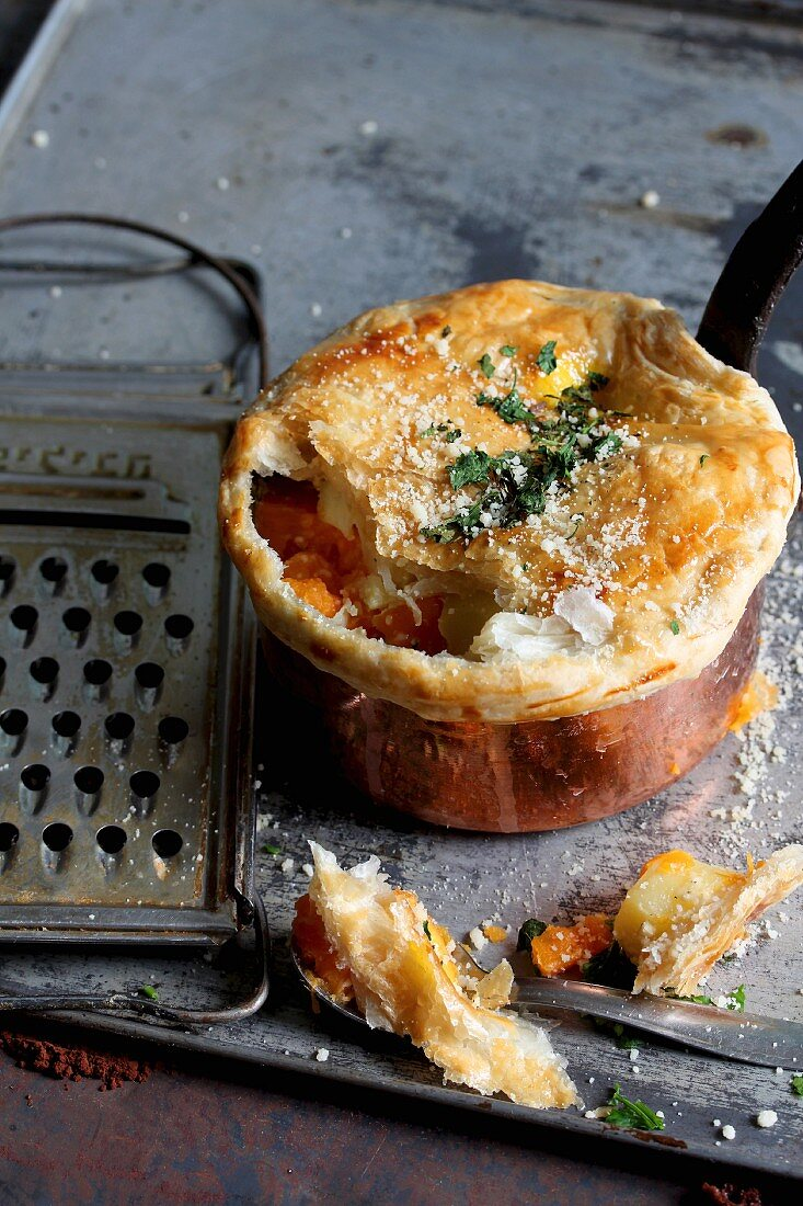 Sweet potato bake with a puff pastry topping and Parmesan cheese