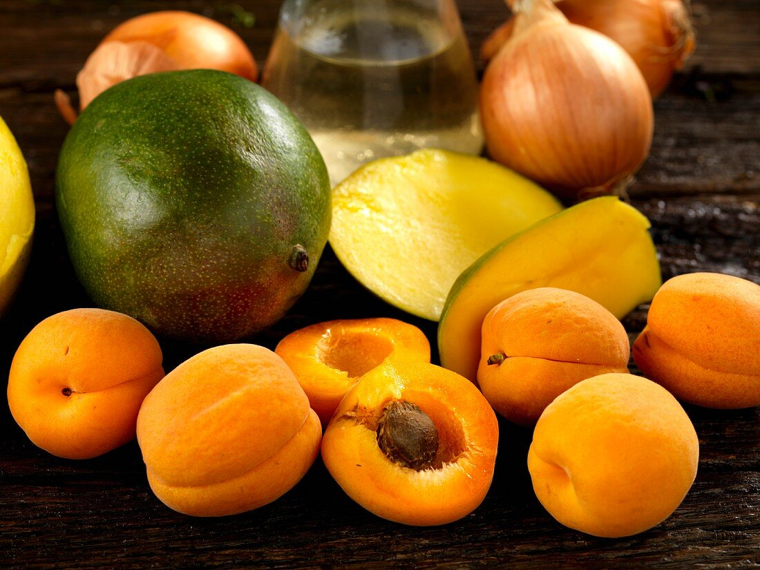 Ingredients for chutney with mangos, apricots, onion and white wine vinegar