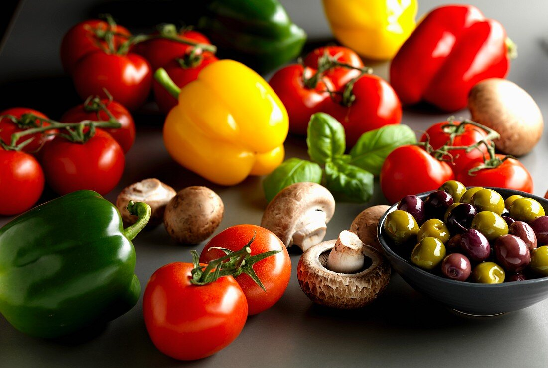 Peppers, tomatoes, mushrooms, basil and olives