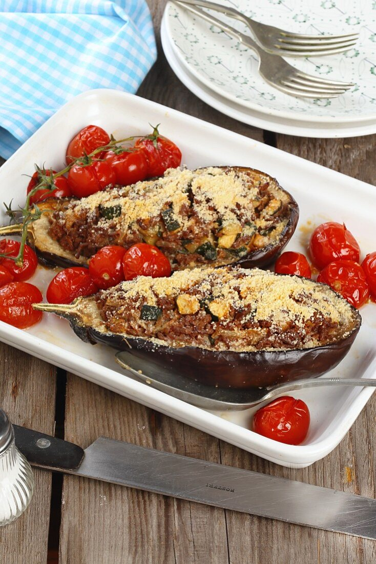 Aubergines filled with minced meat served with oven roasted tomatoes
