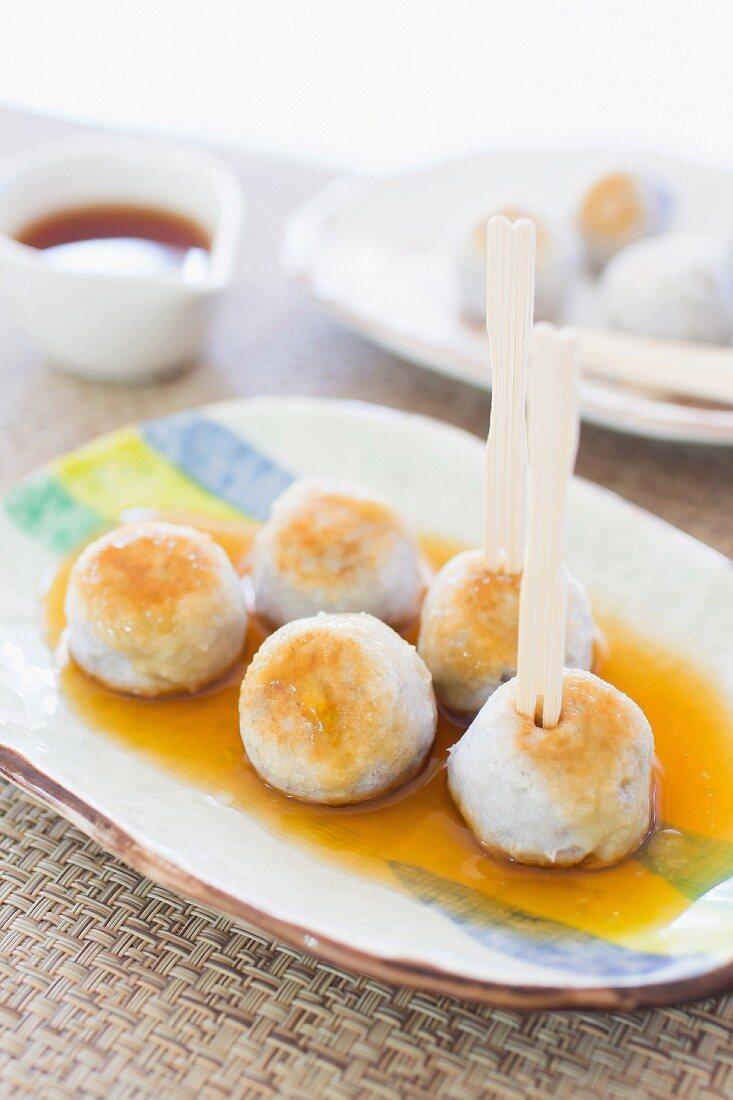 Taro dumplings with a sweet soy glaze