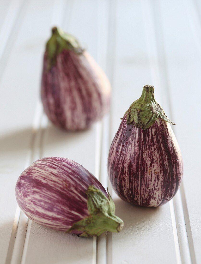 Three aubergines