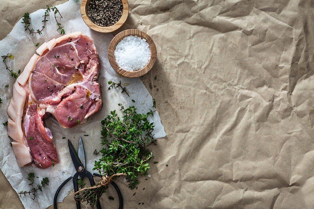 A pork chop prepared for cooking