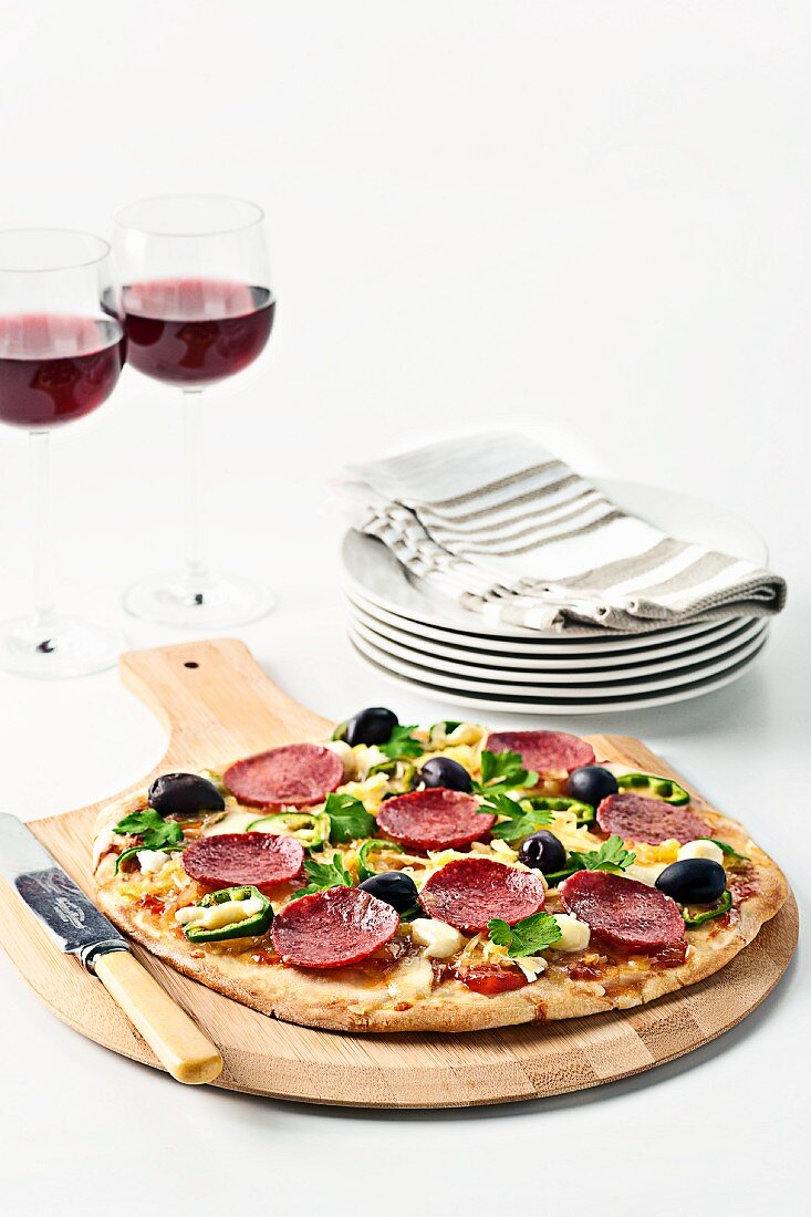 Pizza with salami and olives