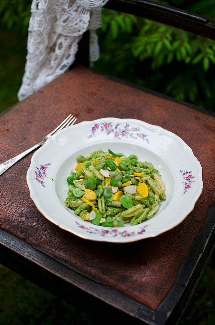 Gnocchi sardi pasta with beans, yellow courgette, basil pesto and flaked almonds