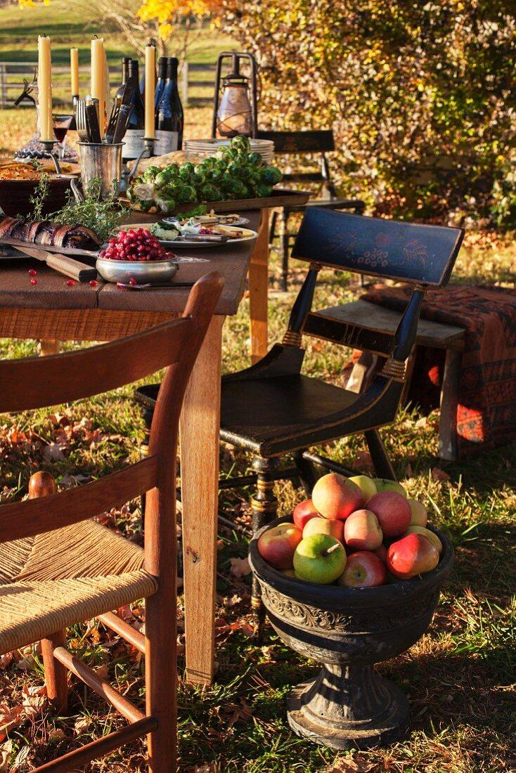 A table laid outside an autumn garden
