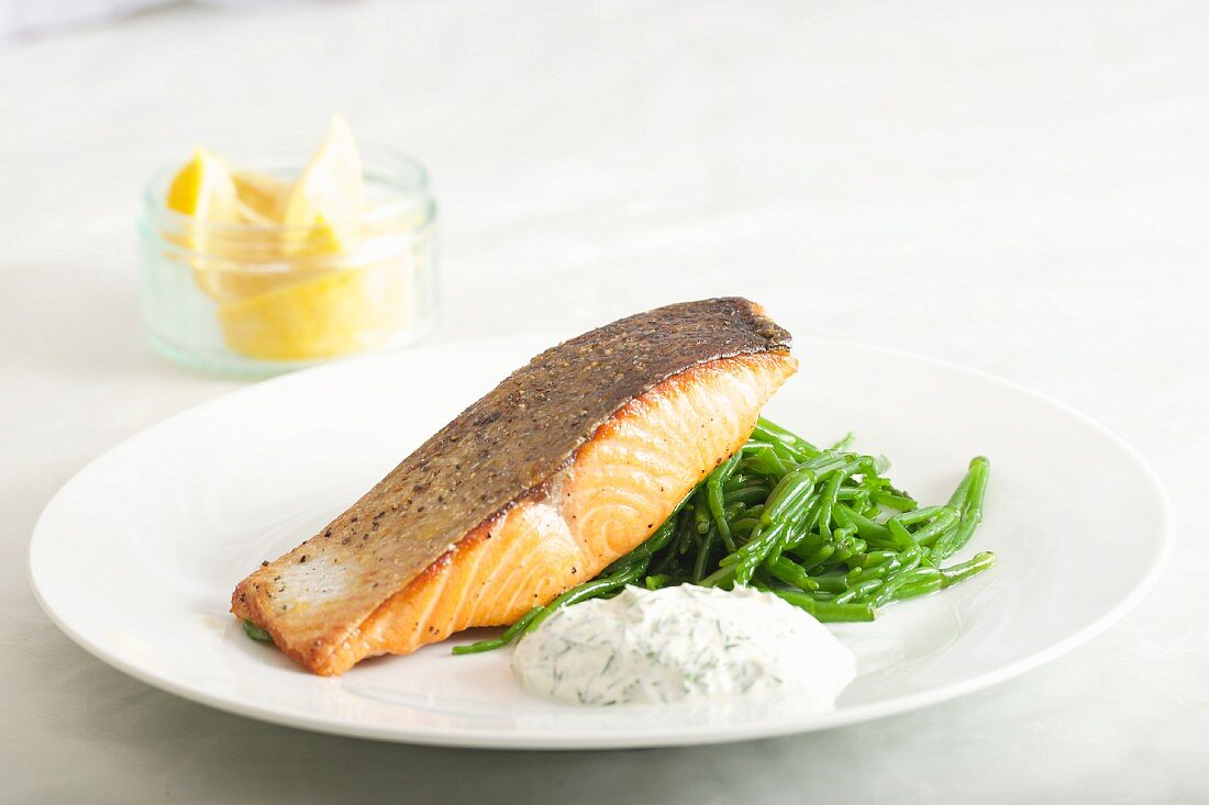 Fried salmon with samphire and a dill cream sauce