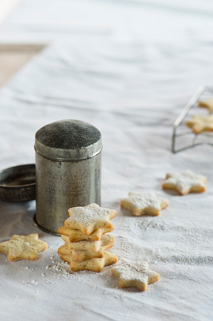 Butter biscuits with an icing sugar dredger