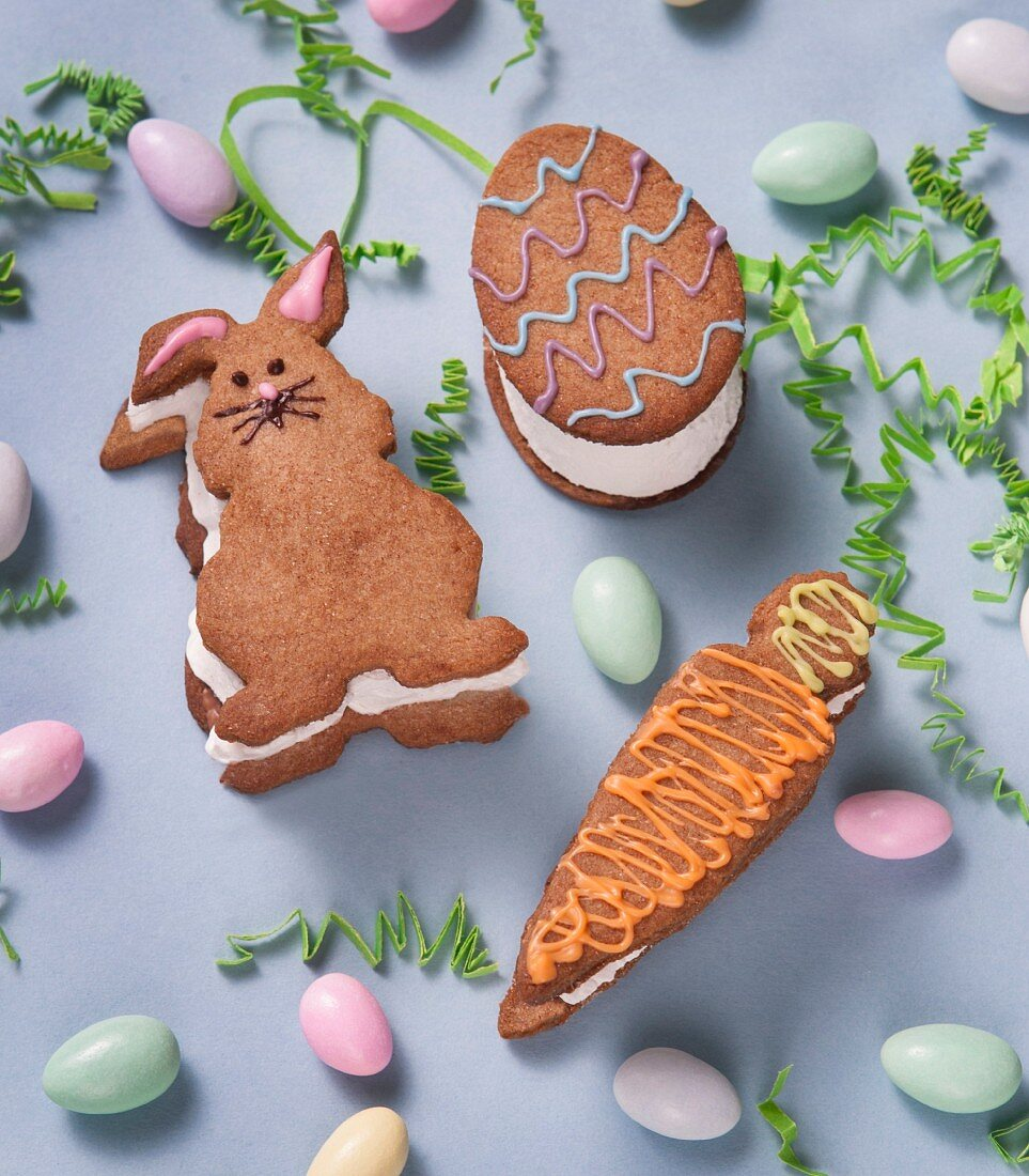 Easter smalls shaped like a rabbit, an egg and carrots made with digestive biscuits