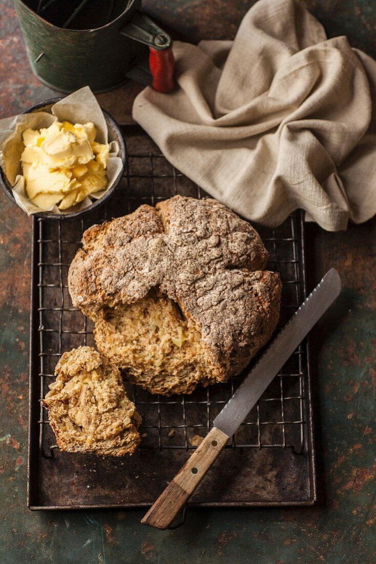 Sliced Irish soda bread next to a bowl of butter