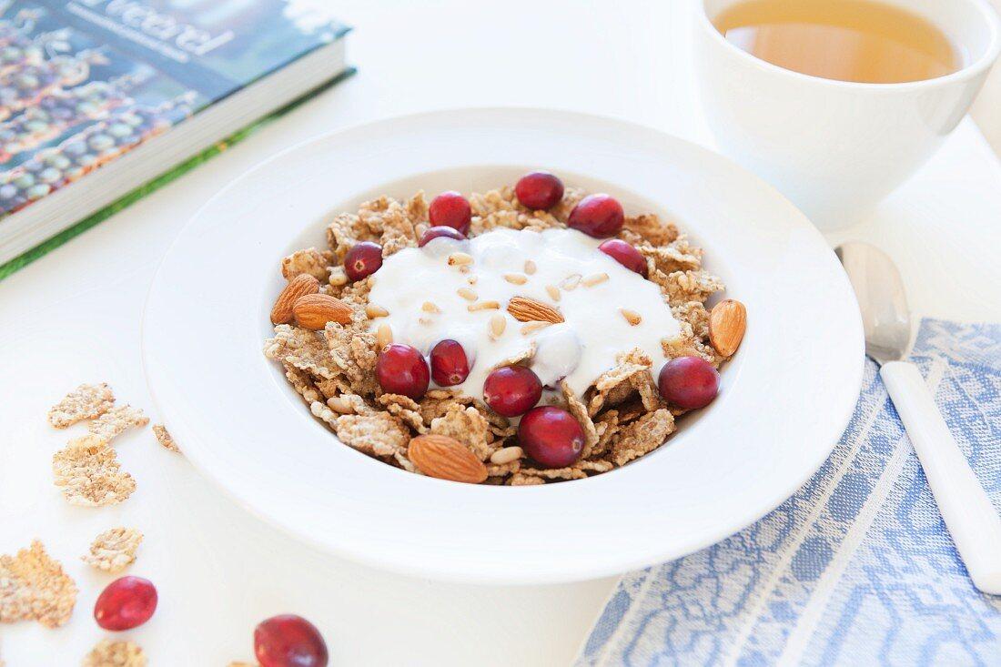 Muesli with amaranth flakes, almonds, cranberries and yoghurt