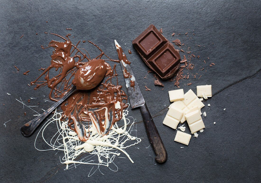 Melted chocolate and squares of chocolate