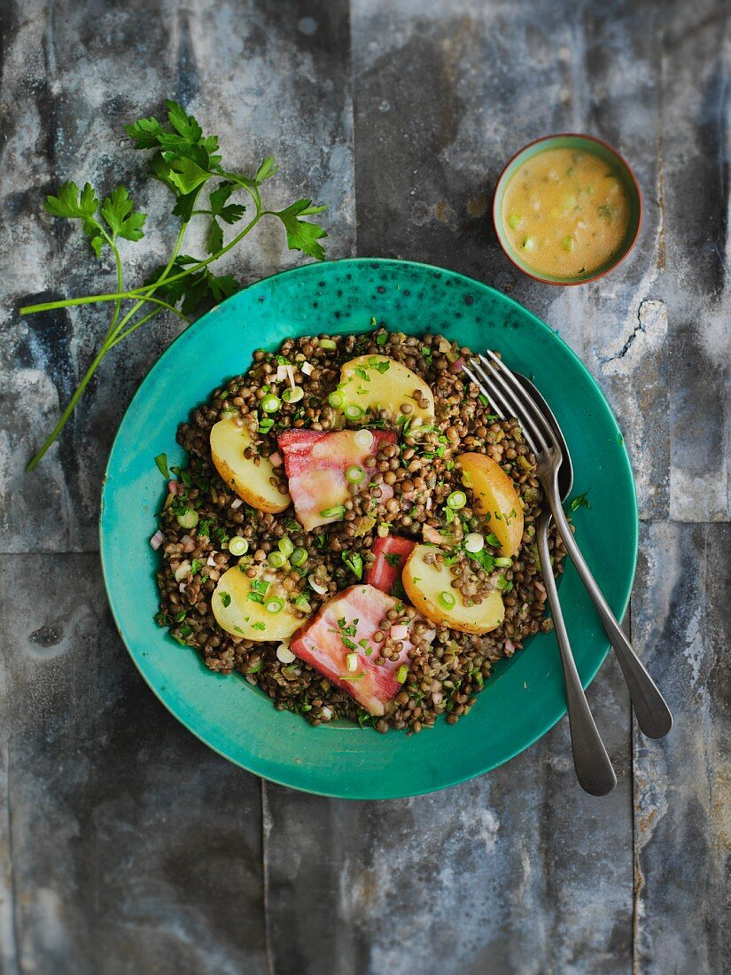 Lentil salad with bacon and potatoes
