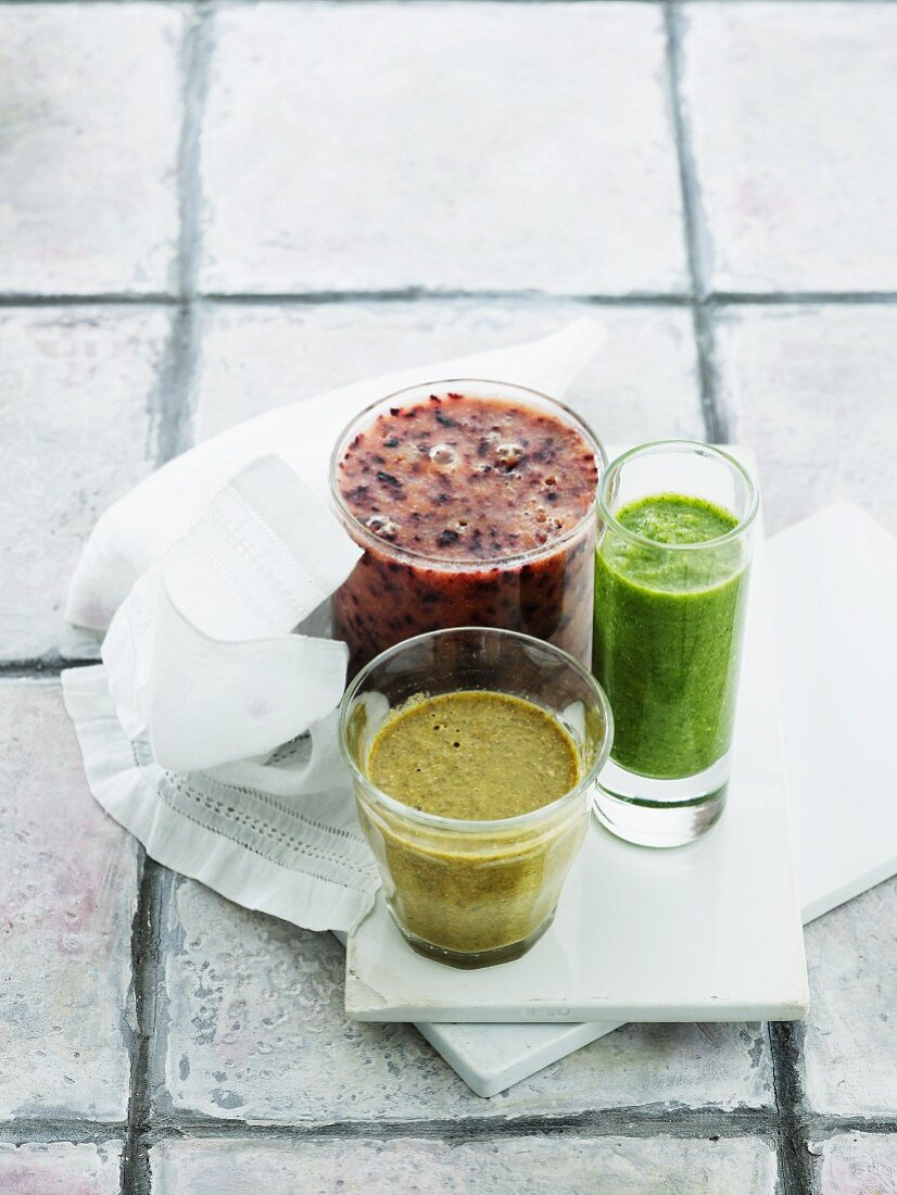 Three different coloured smoothies