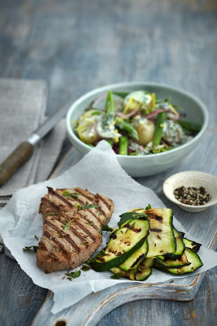 Grilled lamb chop with courgettes and potato salad