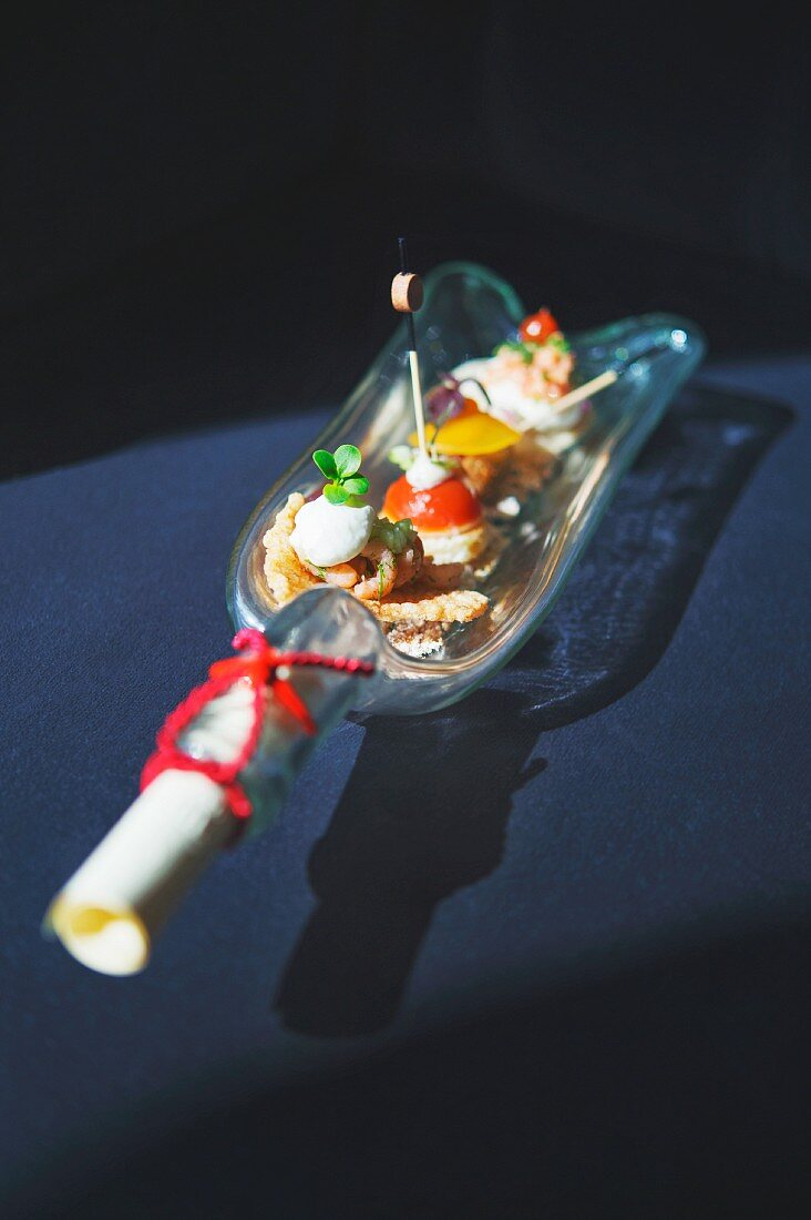 Appetisers served as a message in a bottle at the Grand Village Weissenhaus, Germany