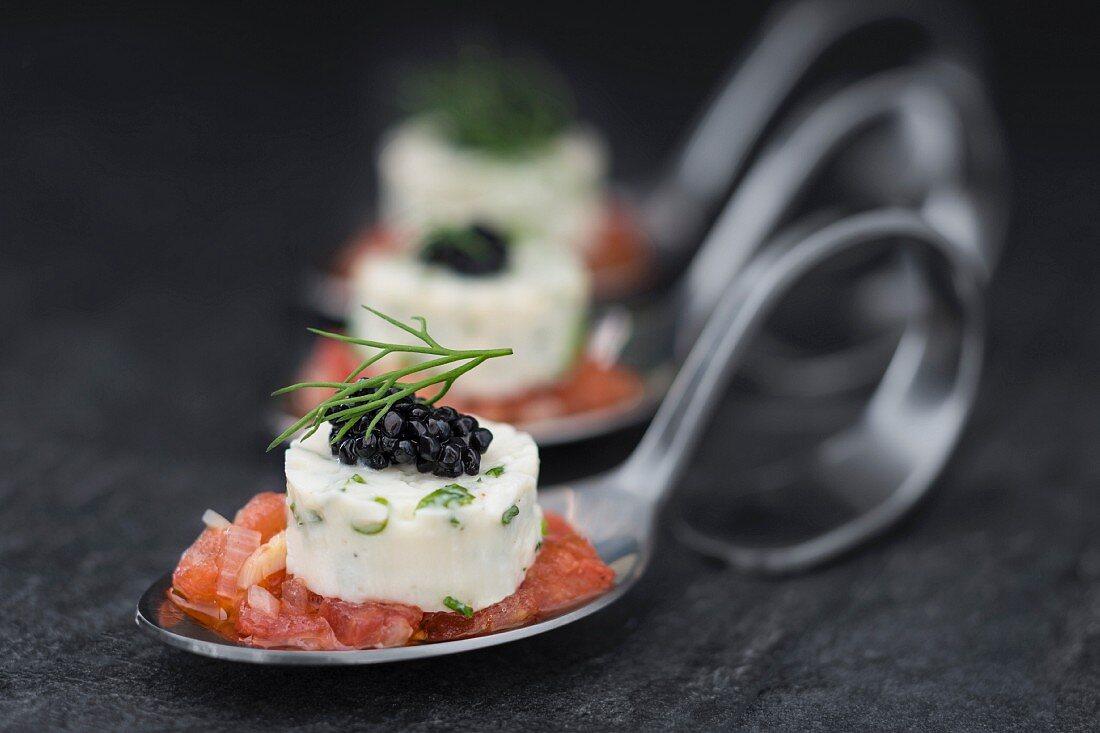 Soya yoghurt terrine on diced tomatoes on canapé spoons