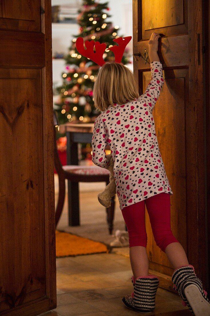 Girl peeping at Christmas tree