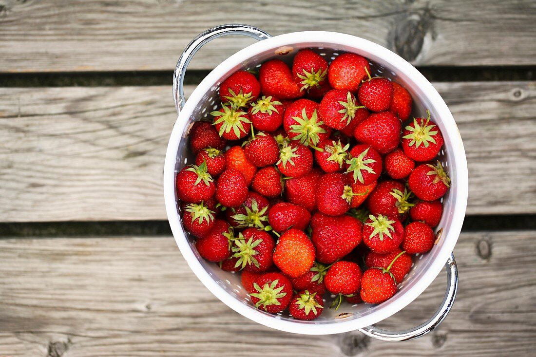 Fresh strawberries in a colander (seen from above)