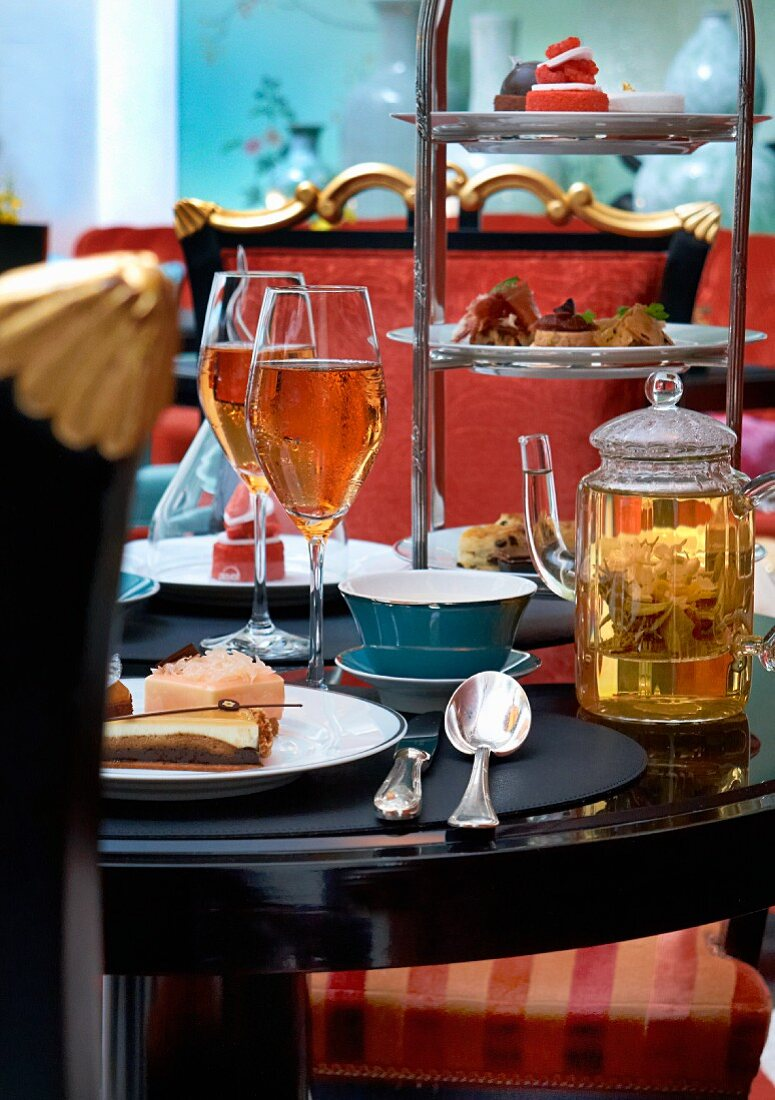 Teatime with sandwiches and petit fours in a restaurant