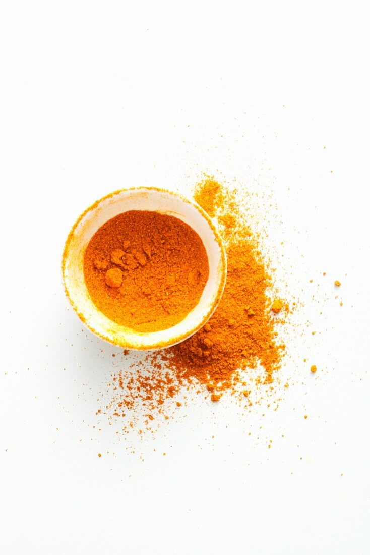 Curry powder in a bowl and next to it