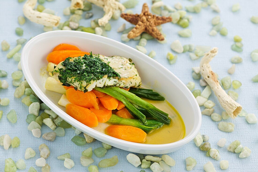 Sea bream fillet with herb pesto and a carrot and spring onion medley