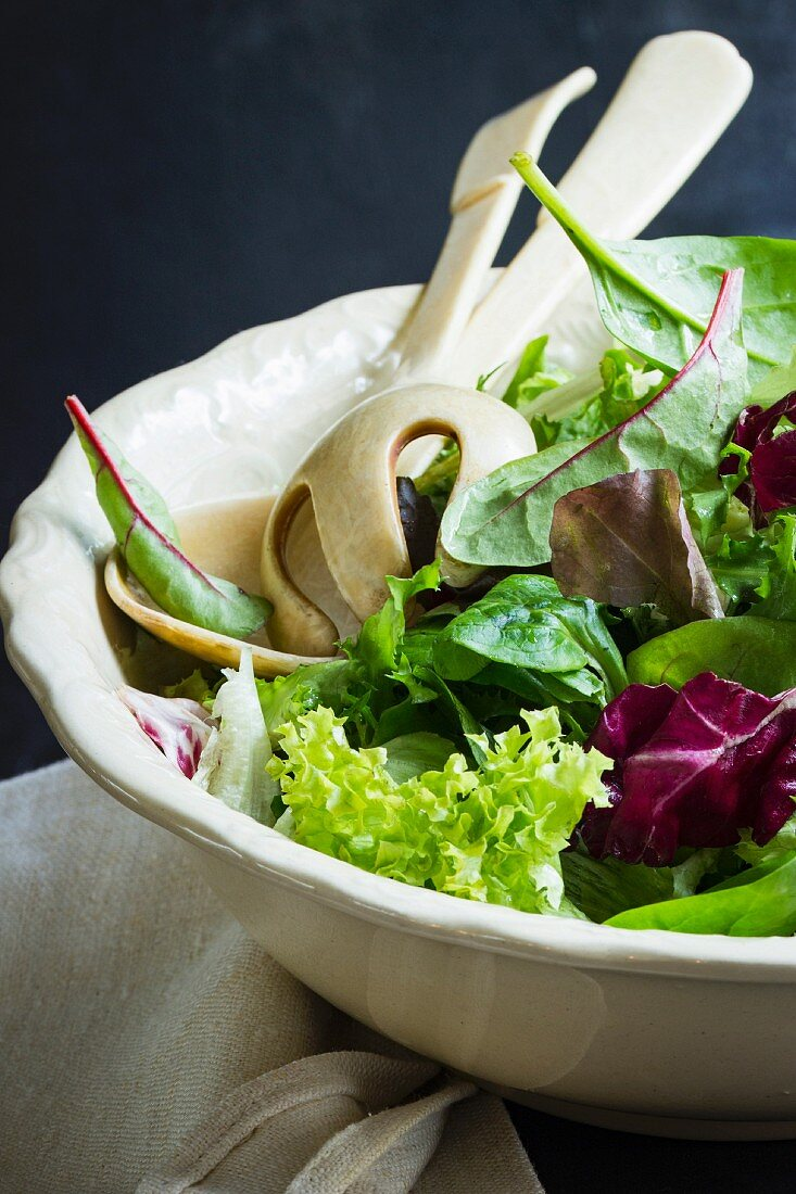 Various types of lettuce in an antique bowl