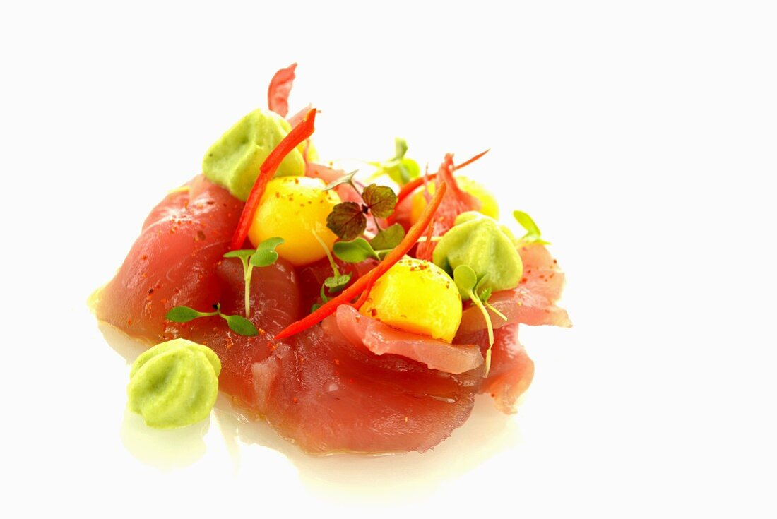 Yellow tuna fish with melons and wasabi