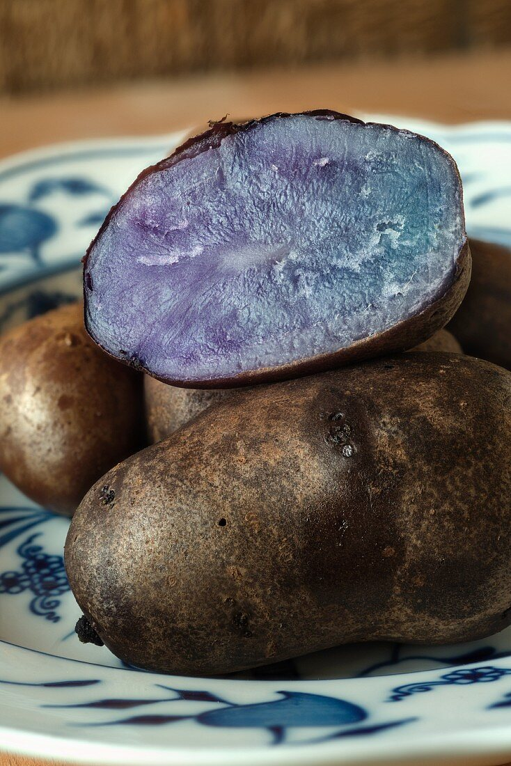 Cooked Idaho Blue potatoes on a plate