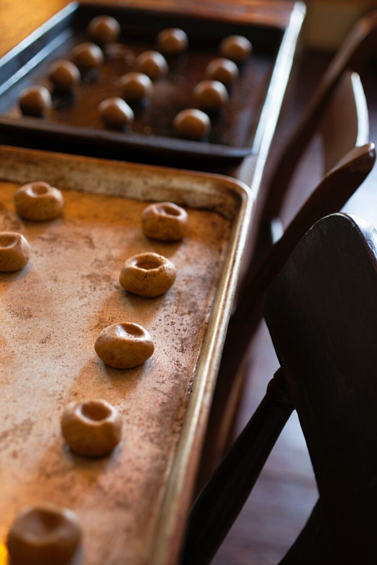 Unbaked ginger snaps on a baking tray