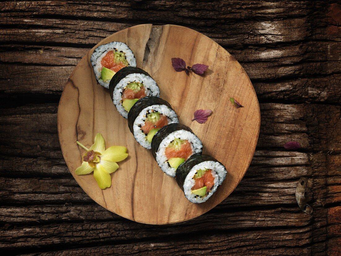 Futomaki sushi with salmon, cucumber and avocado