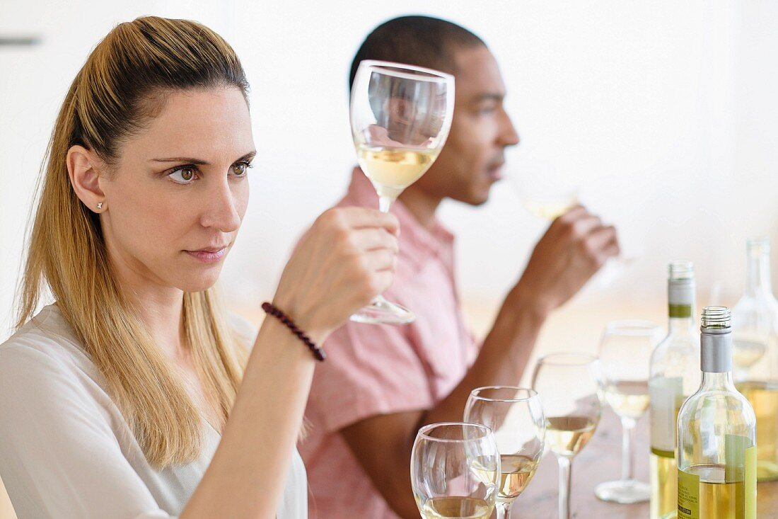 A man and a woman at a wine tasting session