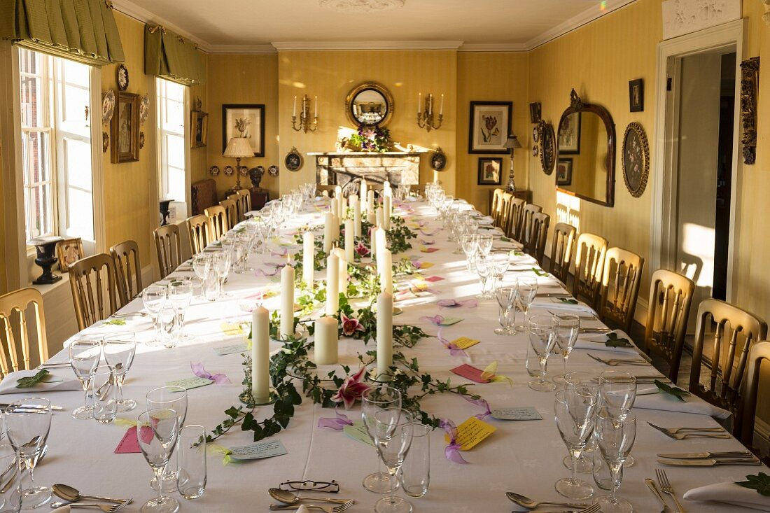Table festively set for birthday dinner in dining room of private Georgian house in Suffolk, England.