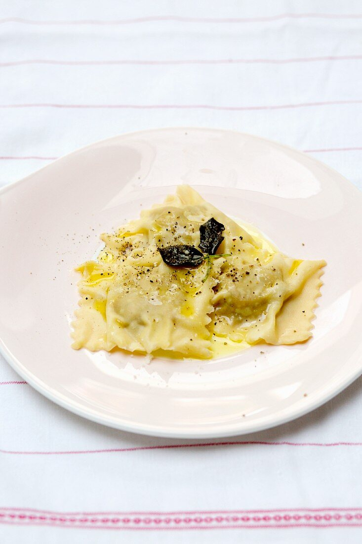 Pumpkin ravioli with butter and Parmesan cheese