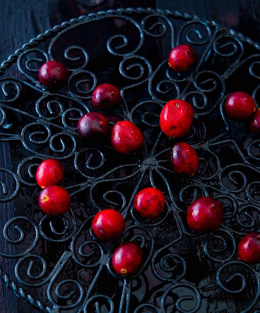 Cranberries on a black cast-iron pot holder