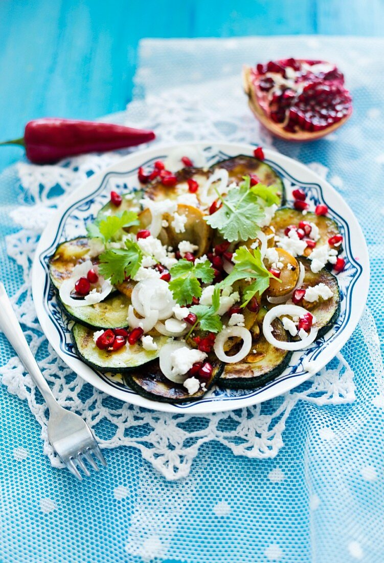 Courgette salad with feta cheese and pomegranate seeds