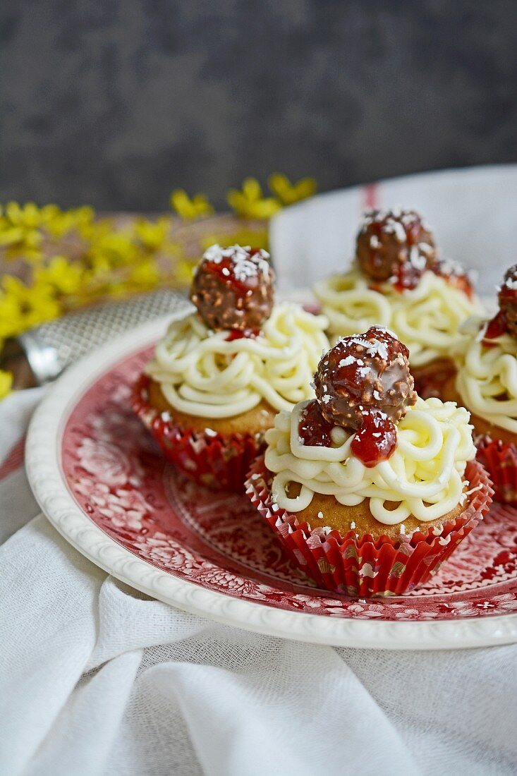 April Fool's cupcakes with fake meatballs, pasta, tomato sauce and Parmesan cheese