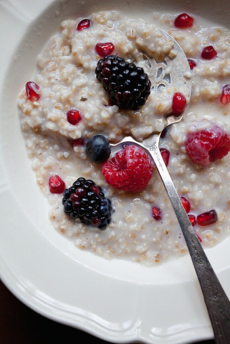 Porridge with berries and pomegranate seeds