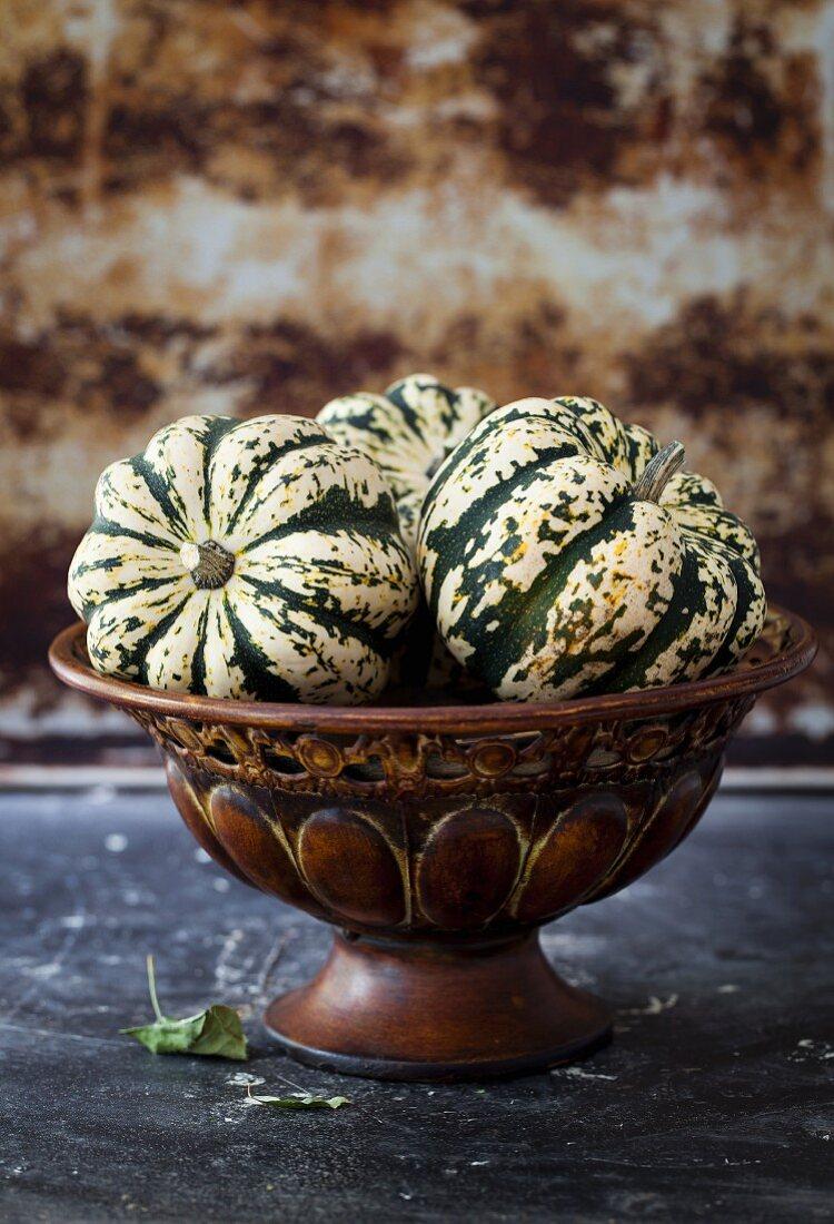 Acorn squash in a decorative bowl