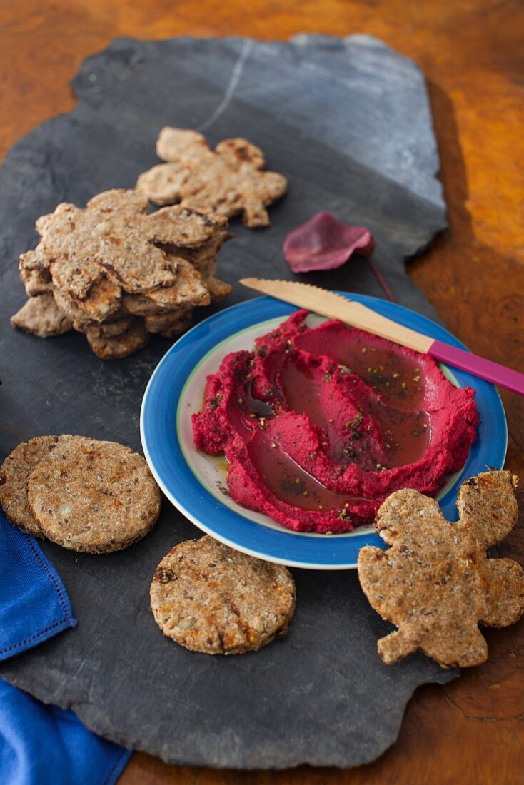 Pumpkin seed and flaxseed crackers with beetroot hummus