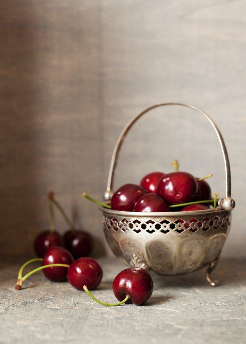 Fresh cherries in a silver bowl