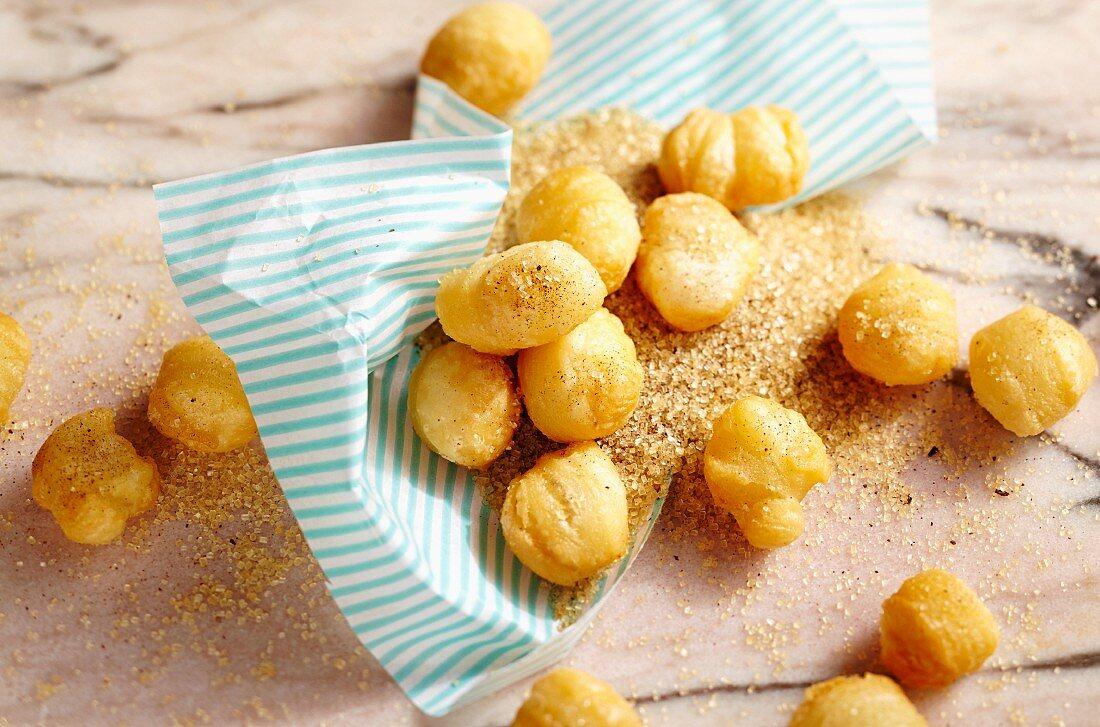 Deep-fried puff pastry balls with tonka bean vanilla sugar