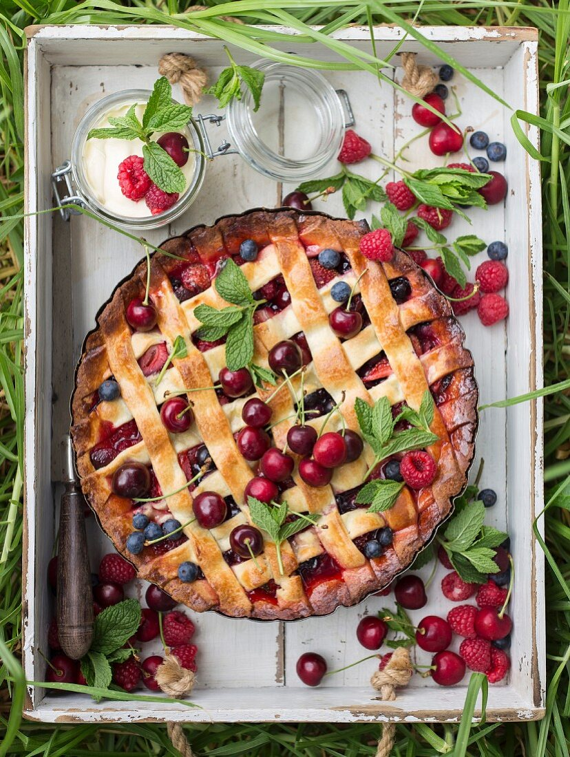A summery fruit pie with a lattice top for a picnic