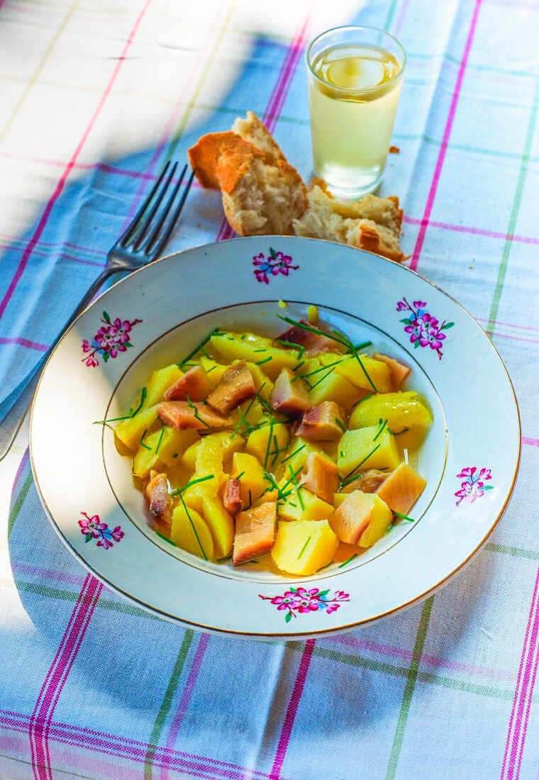Potato salad with herring and chives